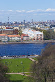 People having a rest on green lawn at bank of Neva river, St. Pe Royalty Free Stock Image