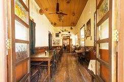 People having rest inside empty room of vintage style cafe in indian city Stock Images