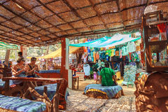 People having rest inside village style cafe in indian crowded resort town Stock Photography