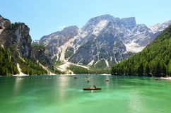 People having a rest time at the mountain lake in italian alps royalty free stock photography