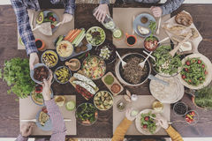 People having vegetarian lunch Stock Images