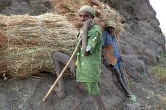 People with hay bundles, Ethiopia Stock Photos