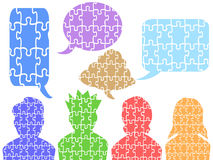 People head puzzle with speech bubbles Royalty Free Stock Photo
