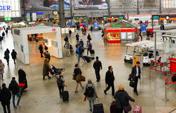 People head for ther trains at Munich Central Station in Germany. Passengers head for different trains at Munich Central Station in Germany Stock Photos