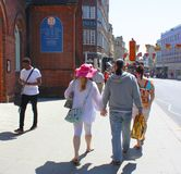 People heading to seafront in Brighton. People heading toward the seafront on a sunny day in Brighton, Sussex, England Stock Photography