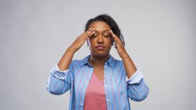 African American woman suffering from headache stock footage