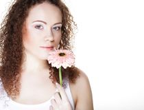 Beautiful young woman with big pink gerber Royalty Free Stock Photo