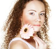 Beautiful young woman with big pink gerber royalty free stock image