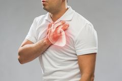 Close up of man having heart attack or heartache. People, healthcare and health problem concept - close up of middle-aged man having heart attack or heartache royalty free stock images