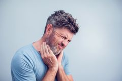 People, healthcare and problem concept - unhappy man touching hi stock photos