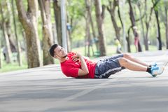 People with a heart attack. Asian cardiac arrest running young man heart attack in park.Severe heartache Royalty Free Stock Images