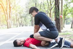 People with a heart attack. CPR with people with a heart attack in park Stock Photos