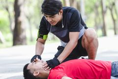 People with a heart attack. CPR with people with a heart attack in park Stock Image