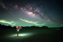 People held orange umbrella under star field. Milky way, Galaxy, People held orange umbrella under star field royalty free stock photography