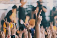 People held two fingers at the concert royalty free stock photos