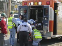 People helping to put into the ambulance sick men. Community emergency respond team helping to put into the ambulance sick men on the who is on the movable Stock Photography