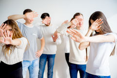 People hiding faces. Group of people hiding their faces with hands Stock Image