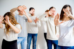 People hiding faces. Group of people hiding their faces with hands Royalty Free Stock Images