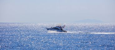 People with high-speed boat in the sea. Stock Image