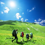 People in hike. People in summer Caucasus mountains Royalty Free Stock Images