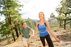 People on hike - couple hiking in forest Royalty Free Stock Photo