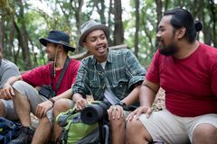 People hiker sitting and talking after hiking. Asian people hiker sitting and talking after hiking in the forest Stock Images