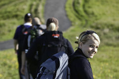 People hiking. A group of people hiking in Iceland with a woman looking back towards the camera Royalty Free Stock Photography