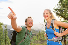 People hiking - couple on hike in forest Stock Photos