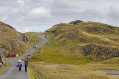 People hiking in Ireland. People hiking in a green path, at Ireland Stock Photo
