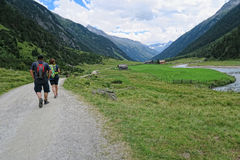 People hiking in the Krimml Achental valley Royalty Free Stock Photos
