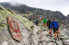 People hiking in line on the path descending from the summit of Rysy, the highest point of Poland Royalty Free Stock Photography