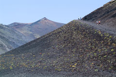 People hiking at mount Etna on the island of Sicily Royalty Free Stock Photography