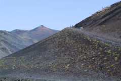 People hiking at mount Etna on the island of Sicily Stock Photos