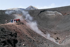 People hiking at mount Etna on the island of Sicily Stock Image