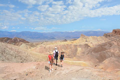 People hiking in the mountains on vacation trip Royalty Free Stock Photos