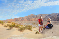 People hiking in the mountains on vacation trip. Royalty Free Stock Photography