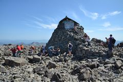 People hiking on path to the Ben Nevis summit Royalty Free Stock Image