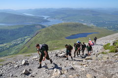 People hiking on path to the Ben Nevis summit Stock Image