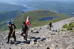 People hiking on path to the Ben Nevis summit Stock Images