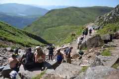 People hiking on path to the Ben Nevis summit Stock Photos