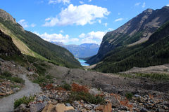 People hiking on the Plain of the Six Glaciers hiking trail near Lake Louise Stock Photos