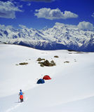 People hiking  on snow , Svaneti landscape Stock Photo