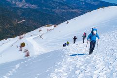 People hiking in the snow at Vardousia mountains in Central Greece- E4 path Royalty Free Stock Images