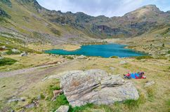 People hiking to Estany Primer in Tristaina, Andorra. TRISTAINA, ANDORRA - OCT 11, 2014: People hiking to Estany Primer - one of the three lakes of Tristaina ( Stock Image