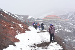 People hiking to the top of Cotopaxi volcano, in Ecuador. Tourists and local people doing the trekking to the peak of the Cotopaxi volcano, in Ecuador, during a royalty free stock photography