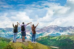 Happy family on top of beautiful mountain holding raised hands . People on hiking trip. Happy family on top of beautiful mountain holding raised hands . View royalty free stock images