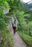 People hiking through Wolfsklamm gorge near Stans in Tirol Austr Stock Images