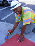 People-Hispanic Worker smiling. Hispanic Latino Man Working on Street Repairs Smiling Stock Photo