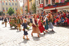 People in historical costumes during Landshut Wedding. People in historical costumes walk during the 2013 Landshut Weddingm in southern Germany,  the historical Royalty Free Stock Photography
