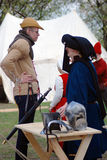 People in historical costumes speak to each other. Stock Images